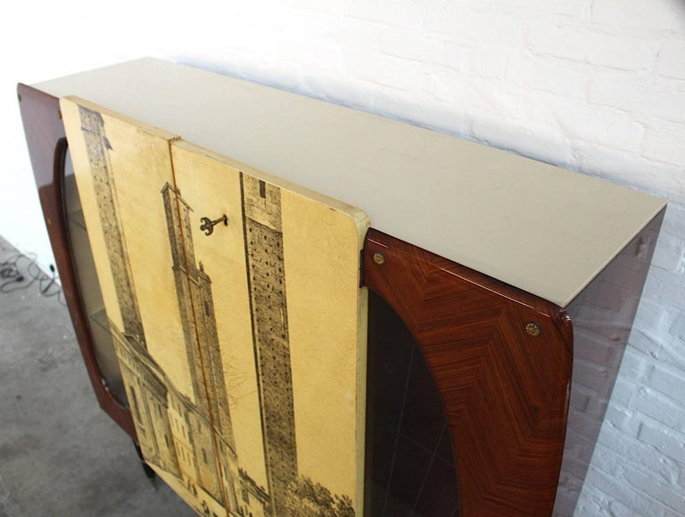Italian Piero Fornasetti Style High Cupboard Featuring the Medieval Twin Towers For Sale