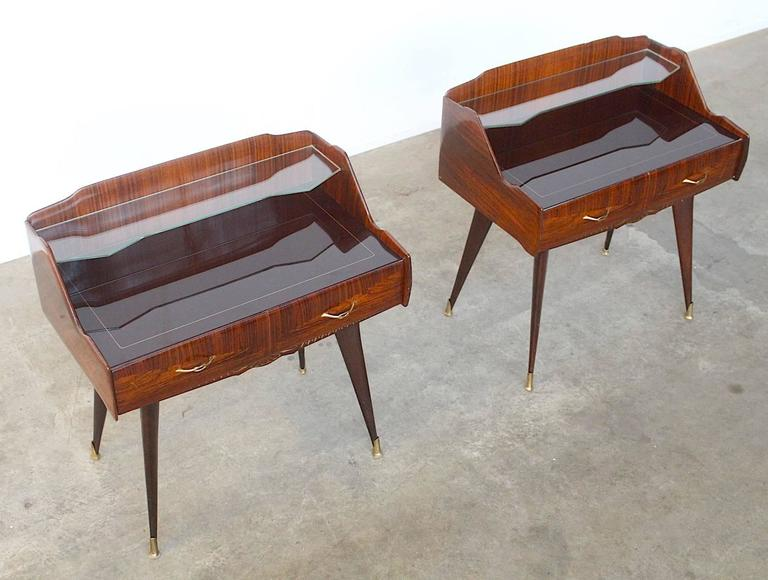 Very exquisite set of two beautifully carved nightstands or side tables executed in Fine rosewood.The size is typical -the nightstands are uncommonly wide, which makes them stand out and being very elegant and eye-catching. Also the glass tops are