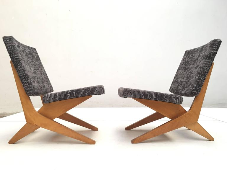 This pair of FB18 scissor chairs has been fully restored and come with new De Ploeg fabric upholstery and foam.  Pastoe is a Dutch company that is known for their beautiful 1950's plywood designs by their main designer Cees Braakman.  This pair
