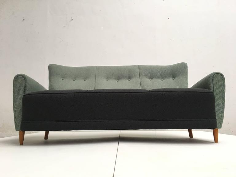 From 1890-1950 Artifort produced mostly high quality traditional furniture and slowly switched to the modernist design in the early 1950s. They took some established names in their collection and had the license to sell Joseph Andre Moth and