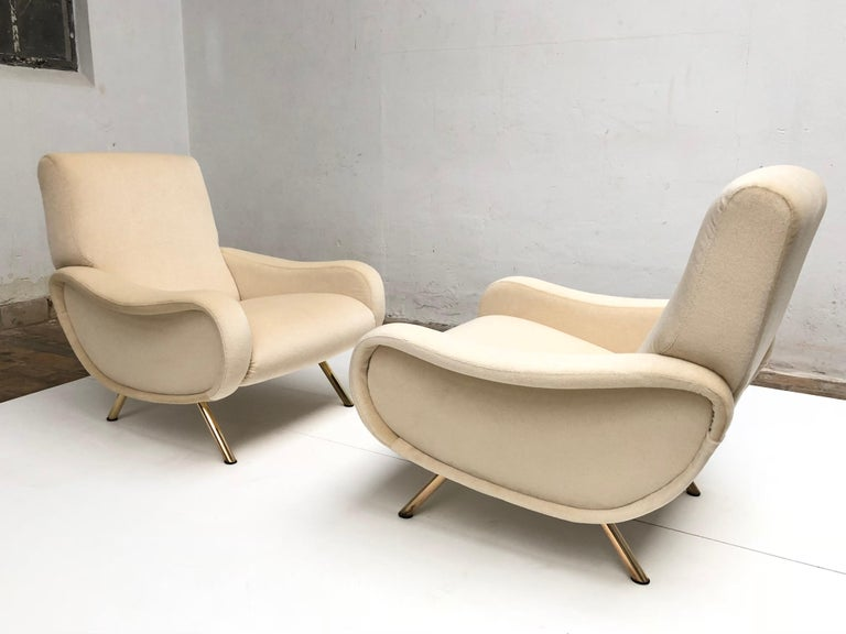 Superb pair of fully restored, very early production wood frame 'Lady' lounge chairs designed by Italian architect Marco Zanuso for Arflex, Italy in 1951.