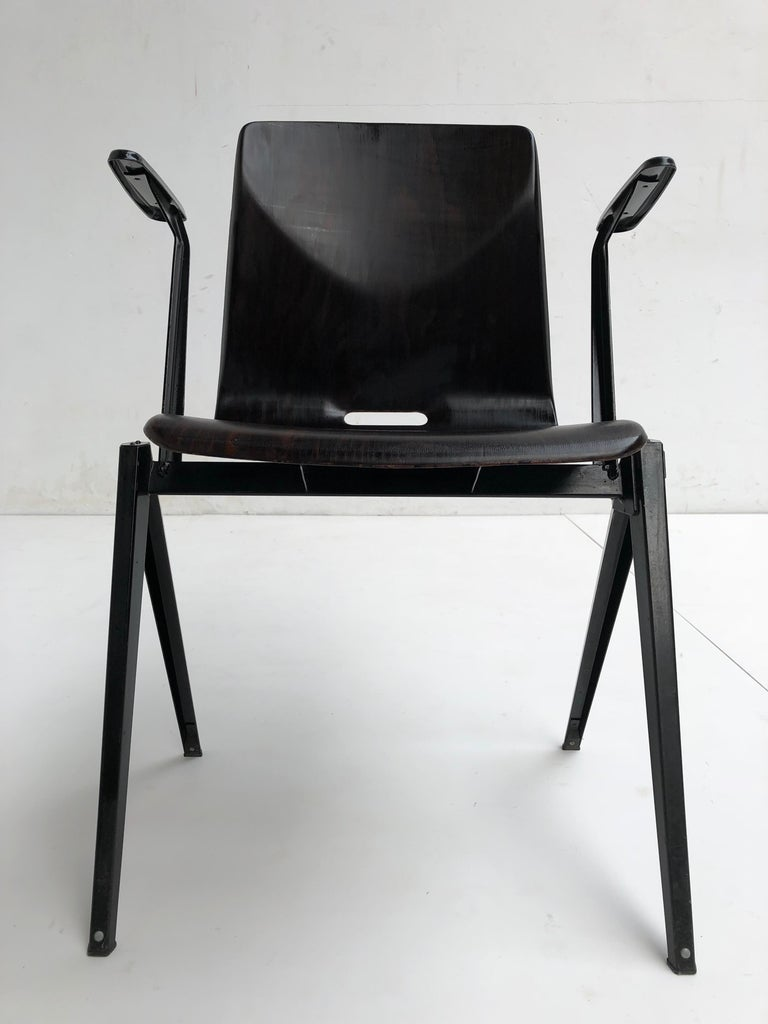 This S22 stackable armchair is made to last, originally designed in the 1960s and still functional today The armrest version is one of the rarer to find models and will be a perfect fit to complement the ends of a table The seats of the S22 chairs