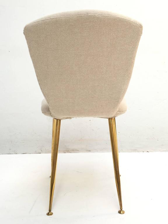12 dining chairs by Louis Sognot for ARFLEX,1959. Brass legs,Upholstery restored 9