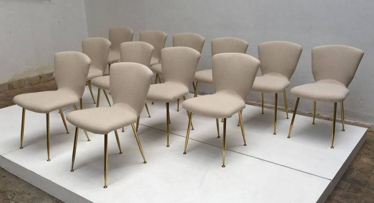 12 dining chairs by Louis Sognot for ARFLEX,1959. Brass legs,Upholstery restored 5