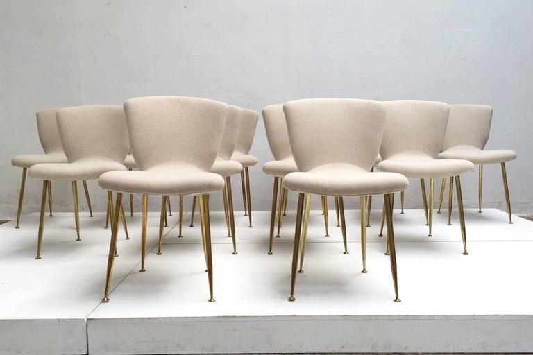 12 dining chairs by Louis Sognot for ARFLEX,1959. Brass legs,Upholstery restored 3
