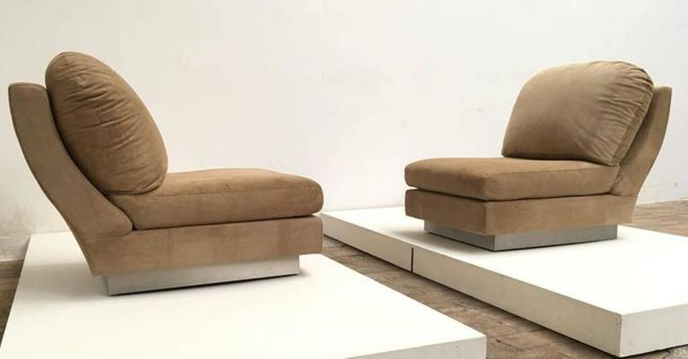 Extremely rare pair of signed Willy Rizzo lounge chairs finished in suede with stainless steel bases. 