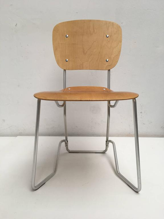 """Large set of 12 Swiss """"Aluflex"""" chairs by Armin Wirth and produced by Aluflex, Switzerland  This ingenious lightweight chair is made out of an aluminium frame and thin birch plywood seat and back and was originally designed in"""