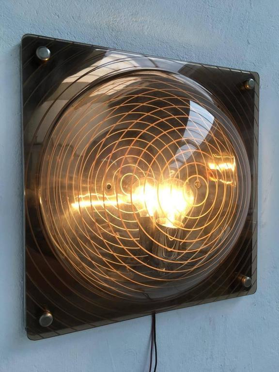 Rare and wonderful light sculpture in the style of important Italian Avant Garde artist Ugo La Pietra. This wall lamp clearly takes its cue from Ugo La Pietra's 'strutturazioni tissurali' studies of the mid-1960s where incised patterns were cut into