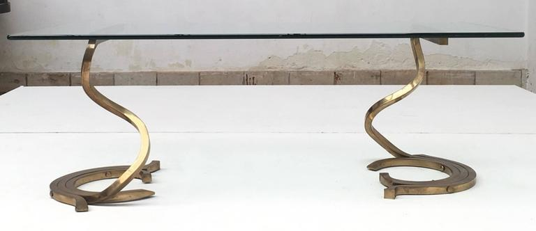 """Rare and beautiful Italian coffee table circa 1968-1972 featuring a pair of beautiful fluid serpentine forms handcrafted and forged from heavy solid (ie NOT plated) brass bar of 0.7874"""" or 22mm cross section, amazing and very heavy quality."""