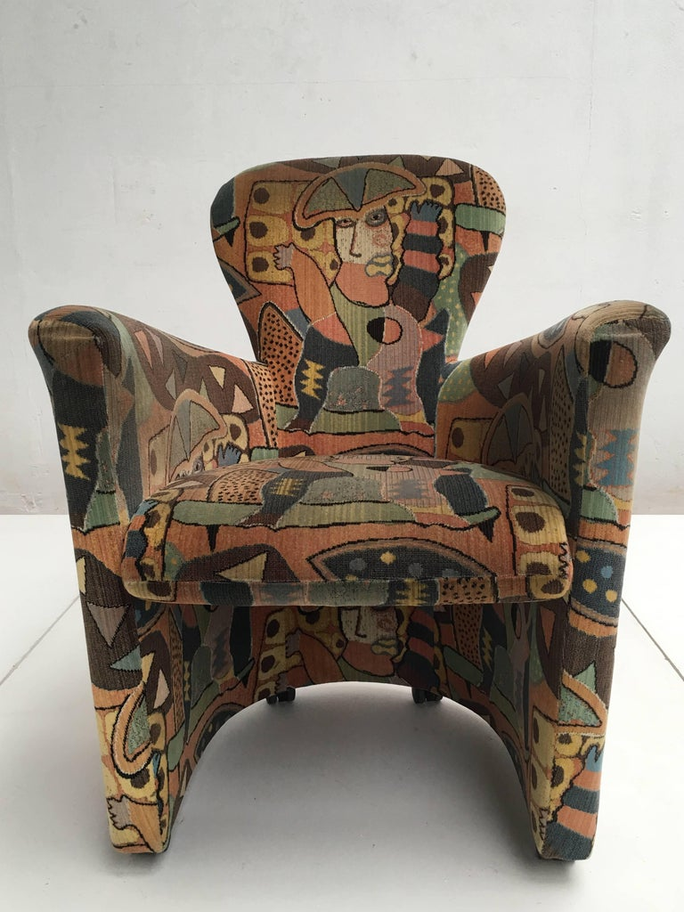 Amphora armchair by designer Frans Schrofer for Leolux The Netherlands 1995  This armchair features a special woven 'Elyata' colourful abstract velvet by Dutch artist Clemens Briels  A very comfortable armchair that is flexible in use because of