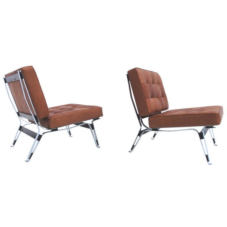 """Lovely and important pair of original 1957 Ico Parisi """"856"""" lounge chairs finished in high quality leather, manufactured by Cassina, Meda (Milan), Italy.  Beautiful design with sculptural form super lightweight bent chromed steel frame with solid"""
