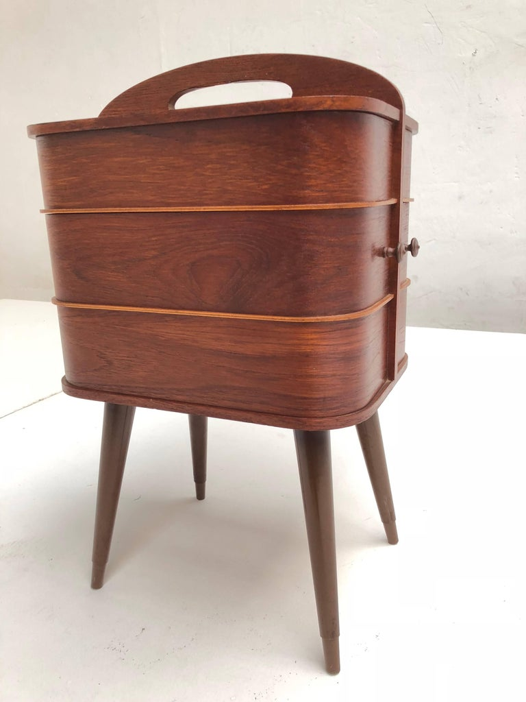 Danish Mid-Century Modern plywood sewing box with integrated handle and revolving drawers