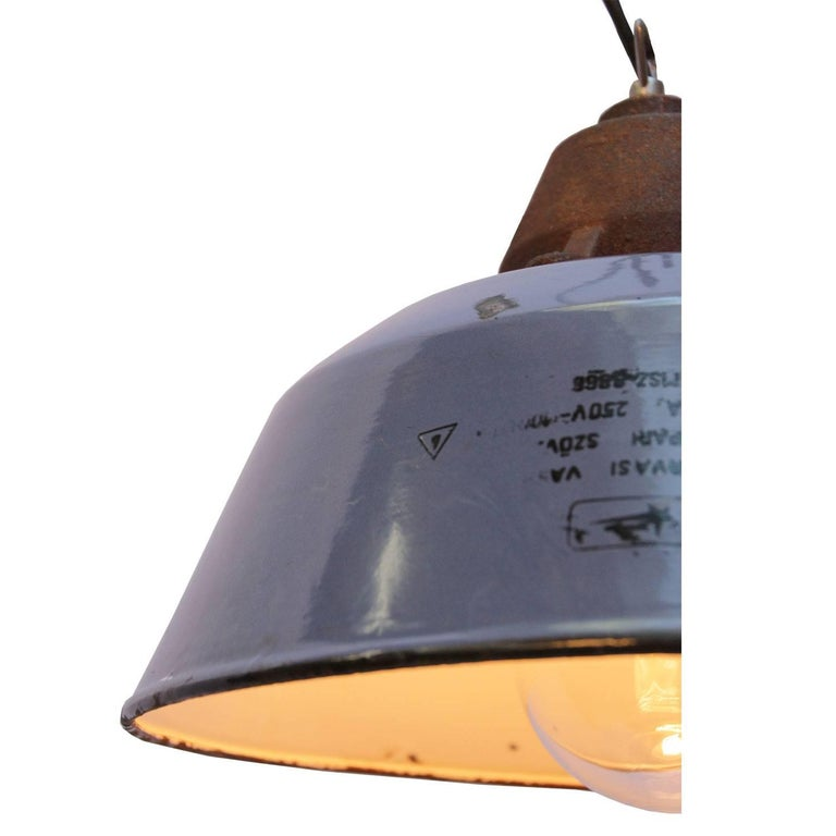 Factory pendant. Blue enamel white interior. Cast iron top with clear glass.  Weight: 3.4 kg / 7.5 lb  Priced per individual item. All lamps have been made suitable by international standards for incandescent light bulbs, energy-efficient and LED