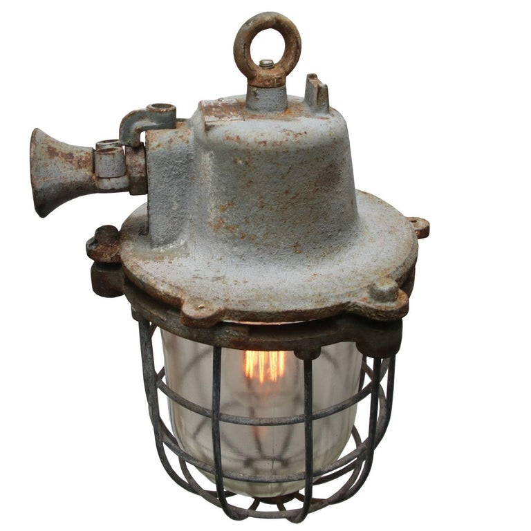 Vintage European Industrial hanging lamp. Cast iron with clear glass.   Weight 9.5 kg / 20.9 lb  All lamps have been made suitable by international standards for incandescent light bulbs, energy-efficient and LED bulbs with an E27 socket, max 150W.