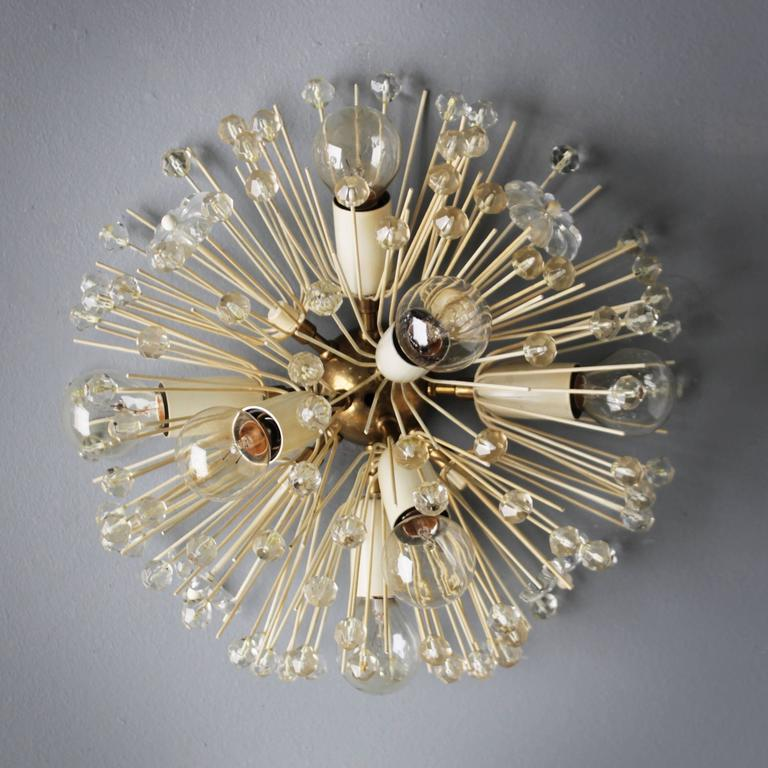 Seven-light blossom flush mount or wall light by Emil Stejnar for Nikoll. Emil Stejnar (1939) was trained as a gold and silversmith in his hometown Vienna. In his lighting designs this background clearly shows in his attention to ornament and his