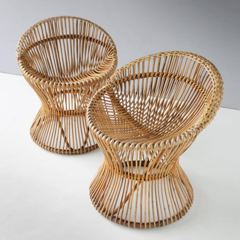 Pair of very rare rattan chairs attributed to Franco Albini for Bonacina Italy. Top condition. Measurements height: 23.6 in. (60 cm), width: 20.4 in. (52 cm), depth: 22.0 in. (56 cm) and seat height: 15.7 inches (40 cm).