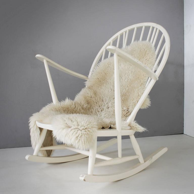 White rare rocking chair by the Italian designer Lucian Ercolani for Ercol, England. The design is based on the English windsor chair. Lacquered elm. The chair is offered without cushions.