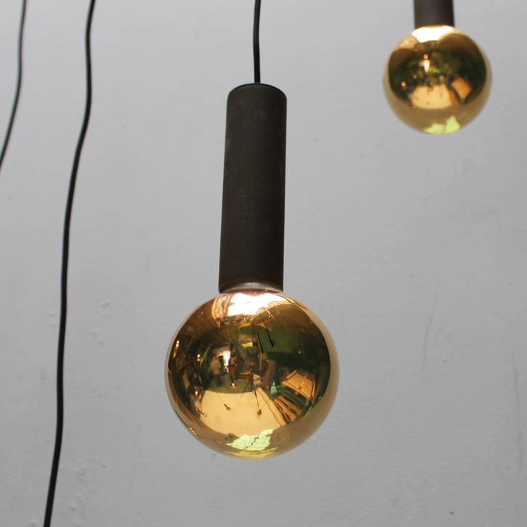 Huge chandelier with twelve gold colored light bulbs for for Colored light bulbs