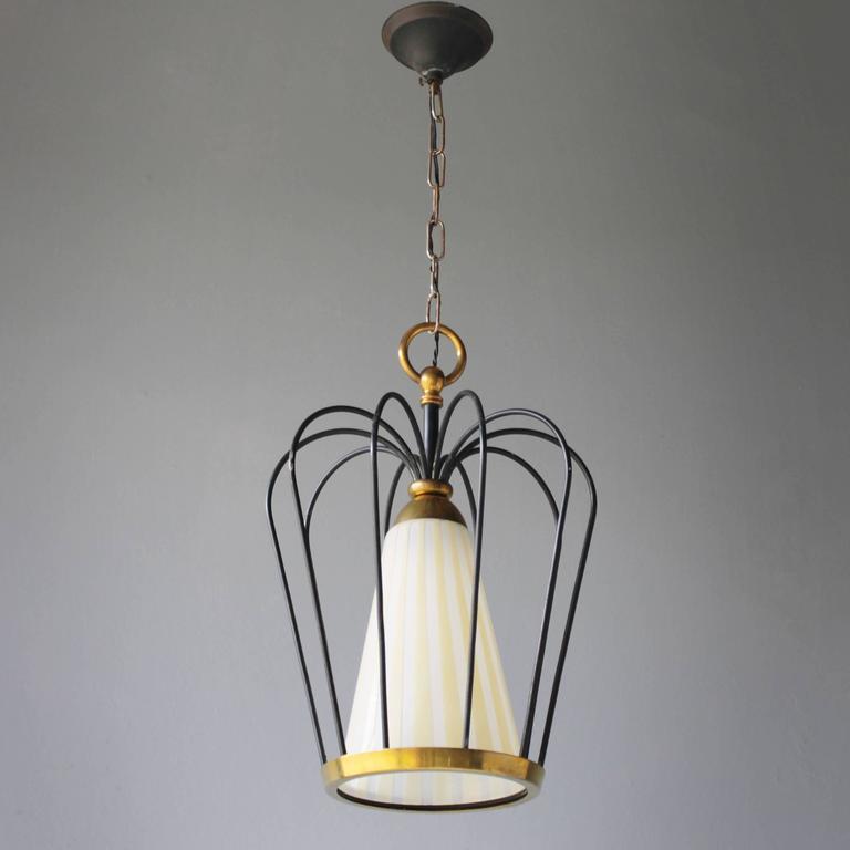 Italian pendant in the style of Stilnovo. One E26/27 bulb. Measures: From ceiling till drop: 29.1 in. (74 cm), height light: 12.6 in. (32 cm), diameter: 11.0 inches (28 cm).