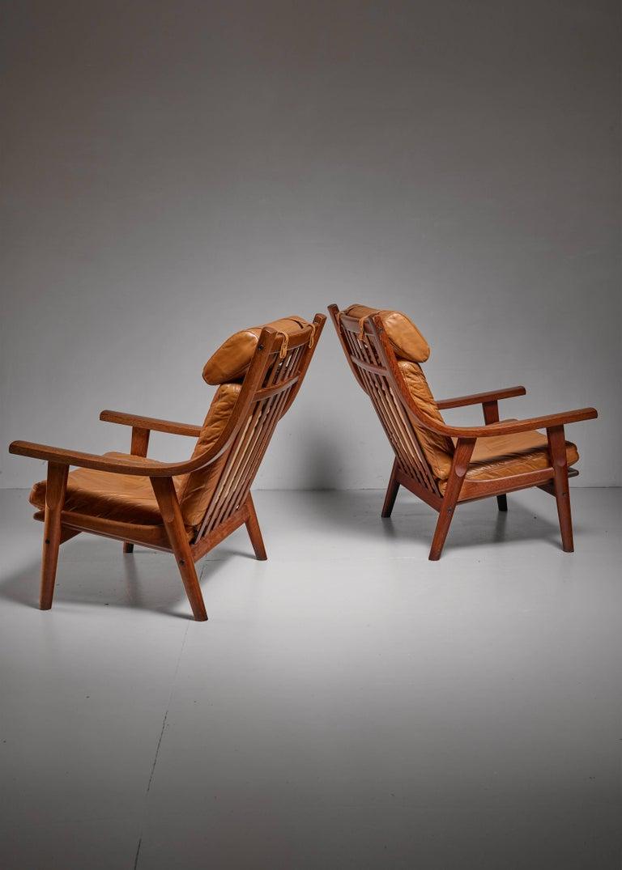 Danish Hans Wegner Pair of Lounge Chairs, Denmark, 1970s For Sale