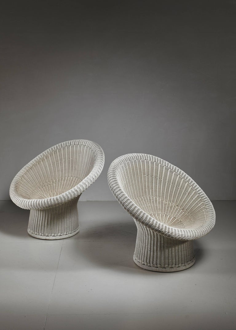 A pair of E10 off-white lacquered wicker chairs, designed in 1949 by German architect Egon Eiermann (1904-1970) for Heinrich Murrmann.