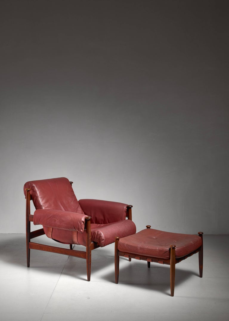 This Amiral armchair with ottoman is designed by Erik for Ire Mobler. It features a rosewood frame and beautiful original leather. Softened from age, giving it the warm lived in feel and without usermarks. The rosewood frame with both chair and