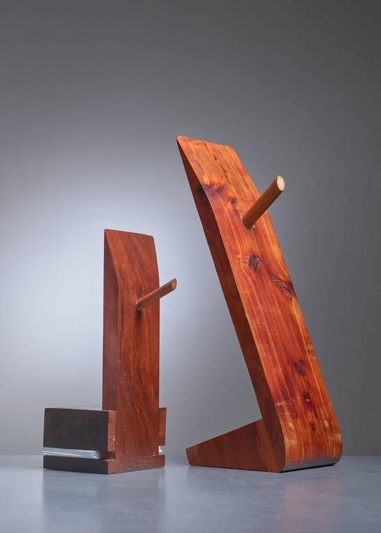 A pair of sculptural wooden bookends by American woodworker David E. Rogers. The measurements stated are of the larger piece. The smaller, adjustable bookend is 32 cm (12.5 inch) high, 17.5 cm (7 inch) deep and 12 cm (4.7 inch) wide.  Dr. David