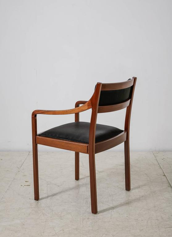 An elegant mahogany armchair with elegant and thin armrests and beautiful black horsehair upholstery. In a good and original condition.