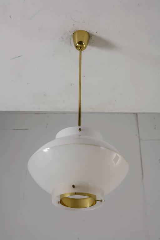 Finnish Yki Nummi White Plexiglass and Brass Pendant for Orno, Finland, 1960s For Sale