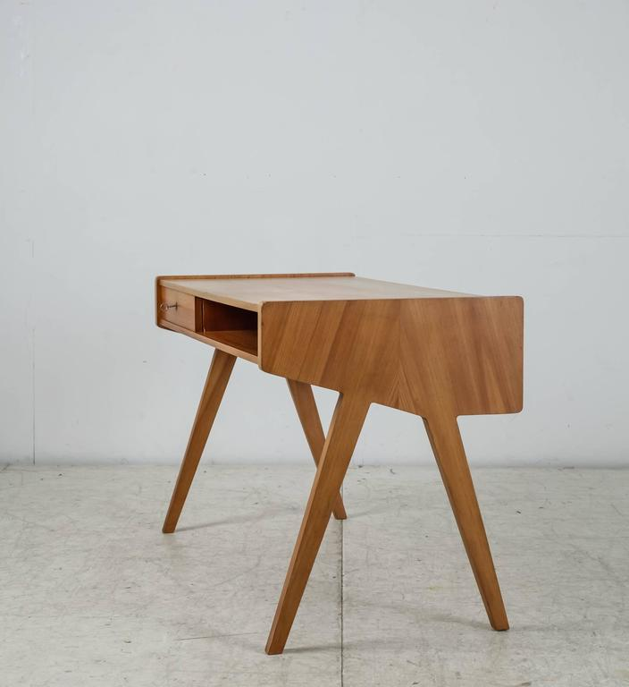 A Small Wooden Writing Desk On V Shaped Legs By German Designer Helmut Magg For