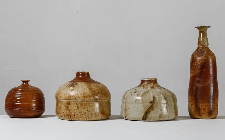 A collection of four vases by French ceramist Franco Agnese.