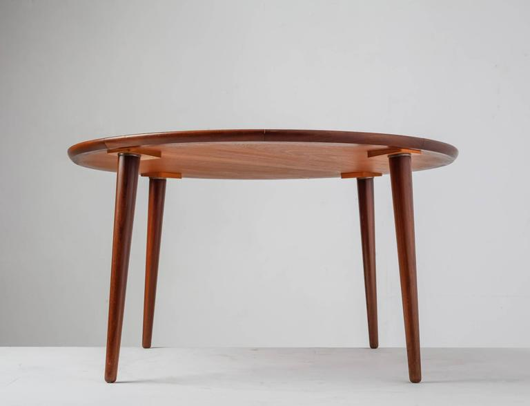 A Round Teak Coffee Table In The Manner Of Peter Hvidt.