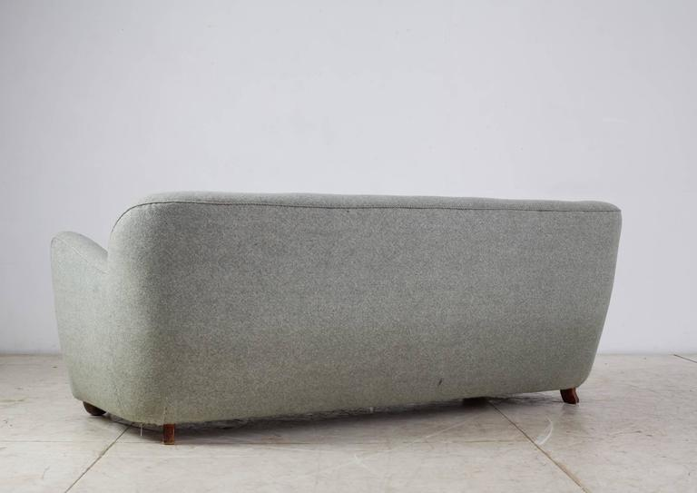 Curved Three-Seat Sofa With Light Blue Fabric Upholstery