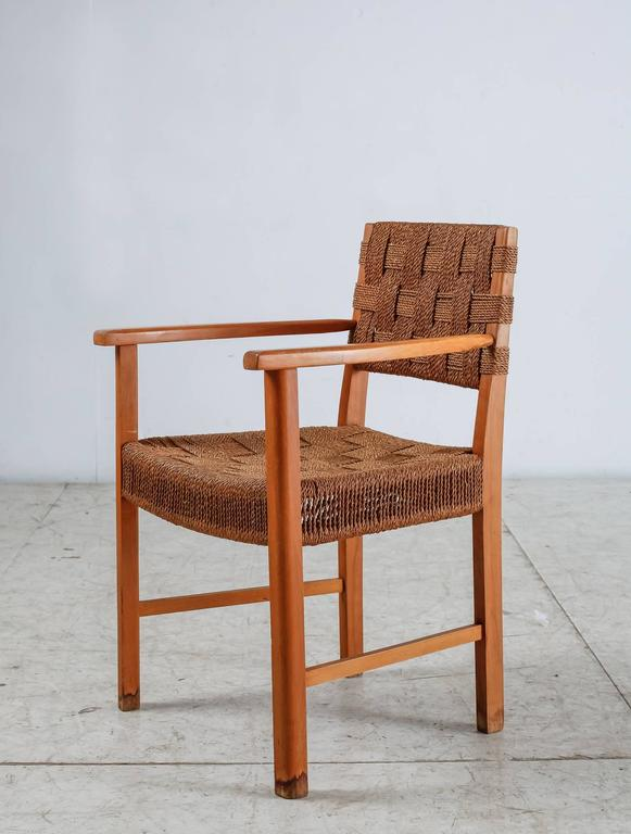 A Danish armchair made of a beech frame with a woven seagrass seating and backrest. The chair and especially the seagrass seating show a strong resemblance to the work of Frits Schlegel.