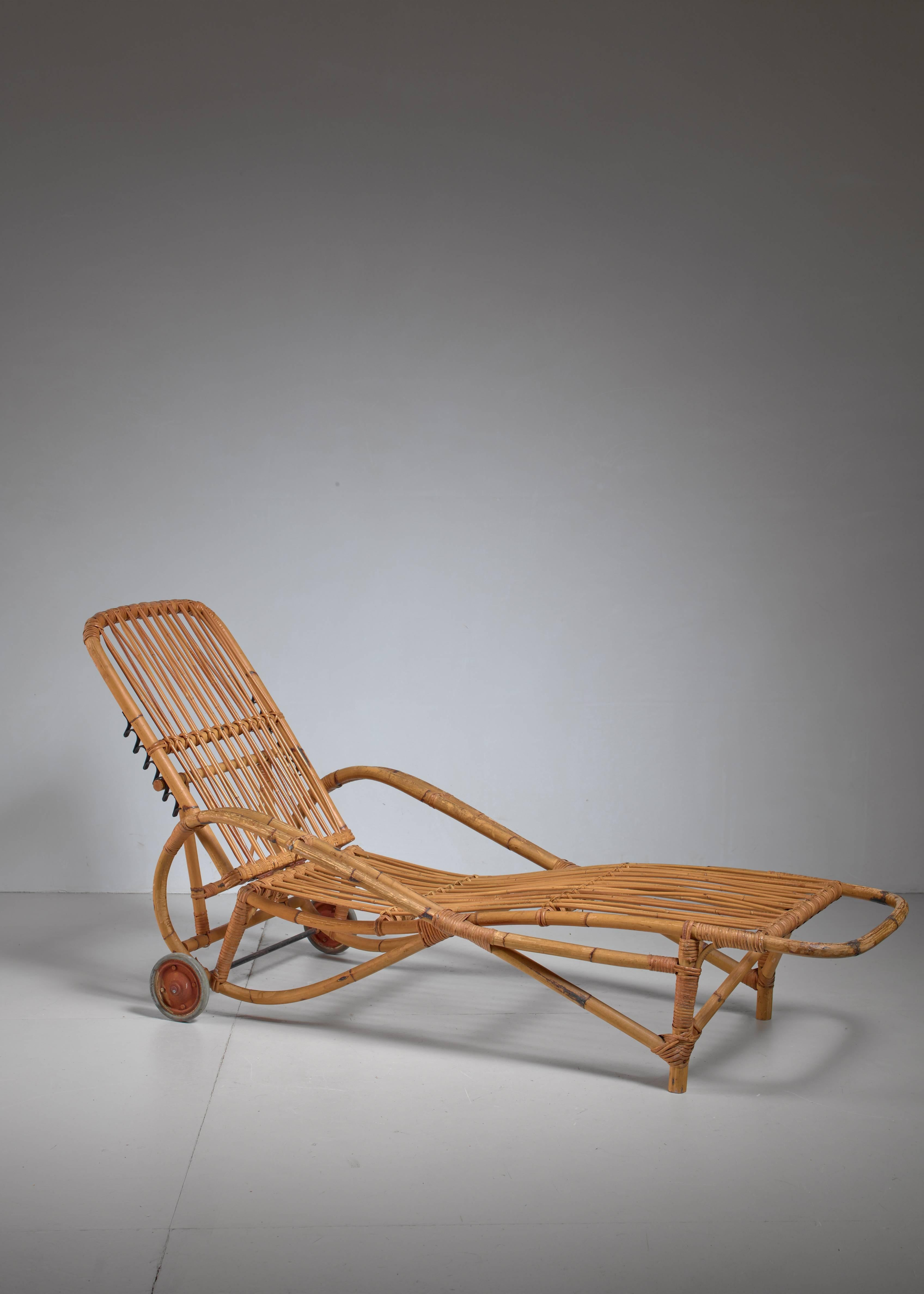A Garden Chaise Longue Made Of Bamboo With Two Rubber Wheels, Strongly  Reminiscent Of The