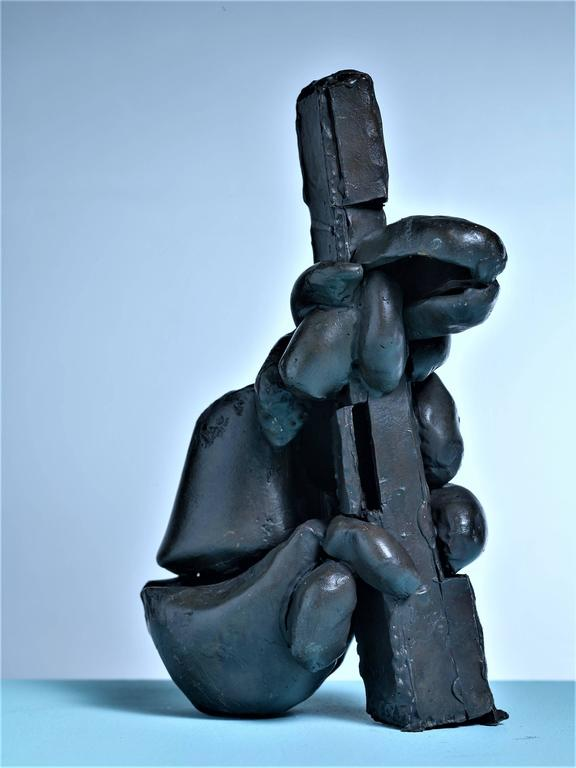 An abstract sculpture in cast, cut and welded bronze by American artist Gene Caples.  This pieces comes from the artist's estate. Eugene Caples (1935-2015) was an artist who earned an MFA in sculpture from Cranbrook Academy of Art in 1965.  * This