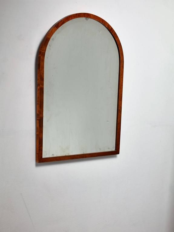 A Swedish wall mirror by Svenska Möbelfabrikerna Bodafors. The mirror has an arched, stained birch frame. Labelled by SMF and in a very good condition.
