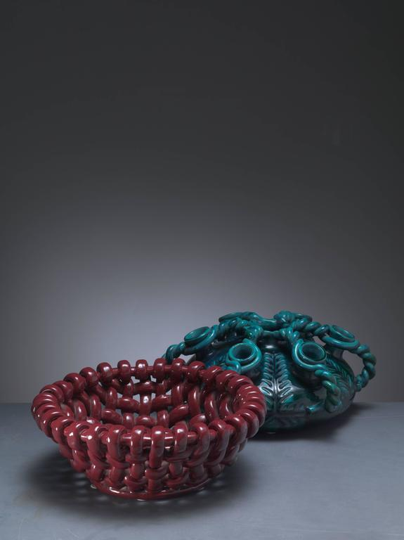 Beautiful combination of a ceramic vase in a blue green color combination and a dark red woven bowl by Jerome Massier for Vallauris.  Dimensions of the red bowl: 32 cm diameter, 13 cm height. Dimensions of the green/blue object: 32 cm diameter,