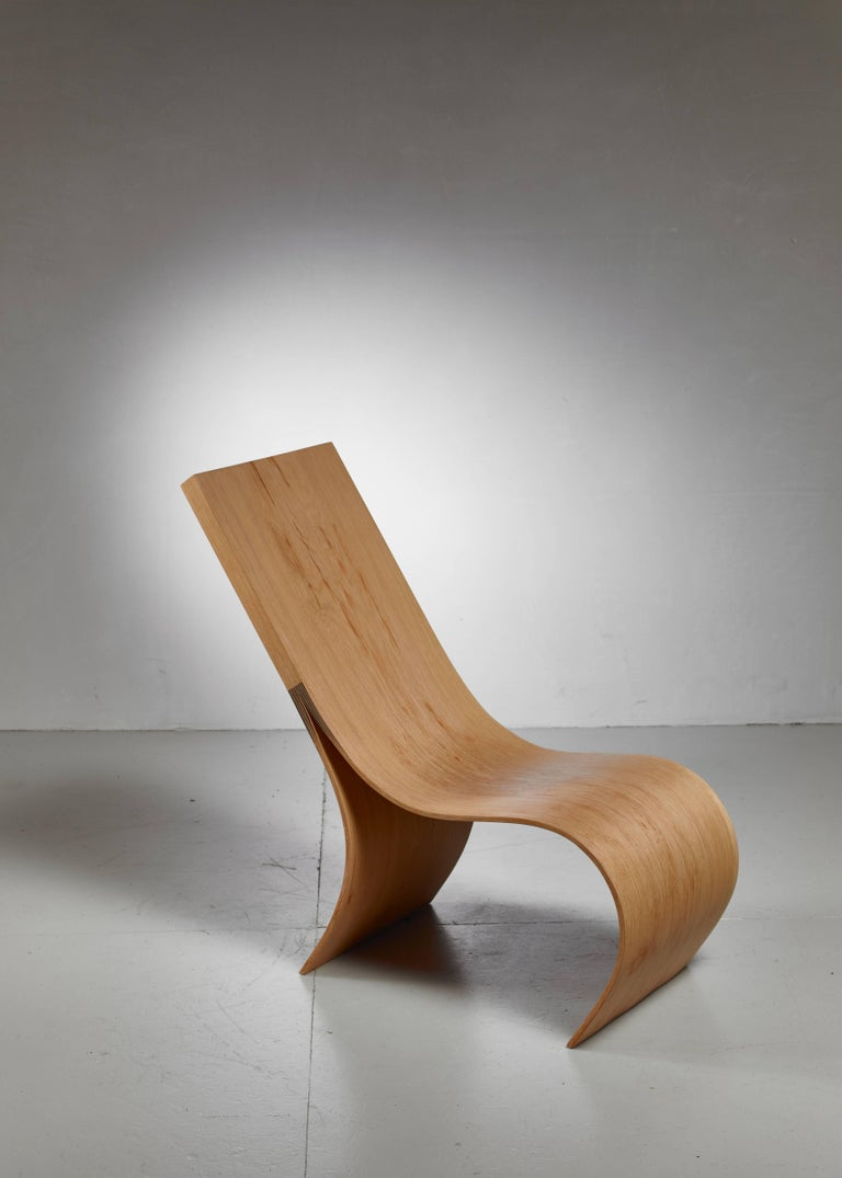 A hand formed lounge chair made from a solid piece of oak from a naturally fallen tree, by Belgian artist Kaspar Hamacher.  Hamacher (1981), son of a forester, uses nature as the main inspiration for his work, with wood being his preferred