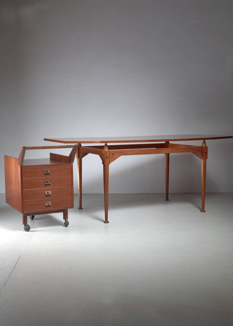 A teak veneer and walnut model TL3 desk or table by Franco Albini for Poggi. Designed in 1951. * This piece is offered to you by Bloomberry, Amsterdam *   The desk comes with a nutwood desk container on wheels, with four drawers and a handle.