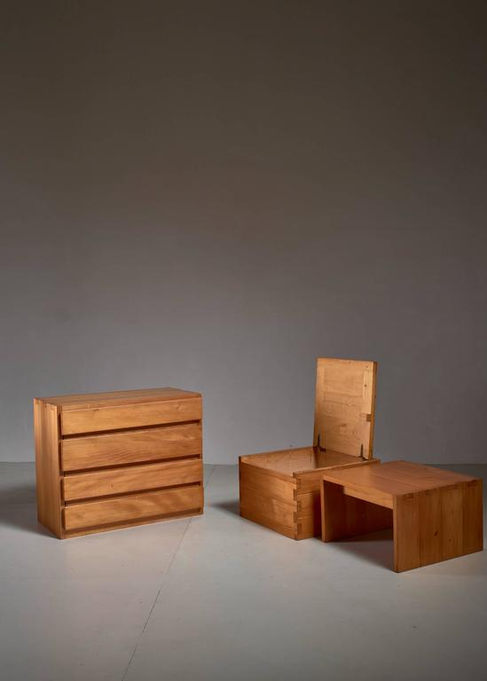 A set of three matching French Campagne style pieces in pine. The set consists of a coffee table, a coffee table / chest with lid and a commode with four drawers. The measurements stated are of the chest. The table with lid is 58 by 58 cm (23 inch)