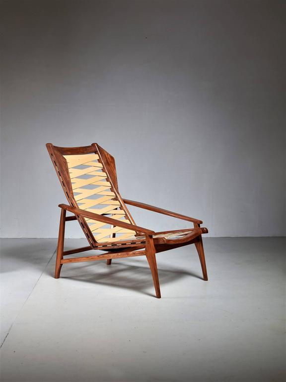 A variation on the model 811 lounge chair, designed by Gio Ponti for Cassina. The elm wingback frame has original Pirelli straps newly applied.  When desired, a cushion can be custom-made in our in-house atelier. * This piece is offered to you by