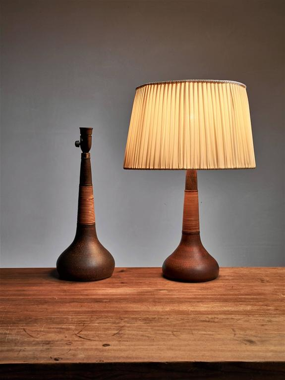 Pair of brown ceramic and rattan table lamps by khler denmark for a pair of table lamps by nils khler the lamps are made of brown ceramic aloadofball Choice Image