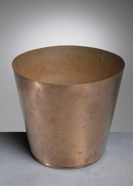 A hammered brass planter by German metalworker Hayno Focken.