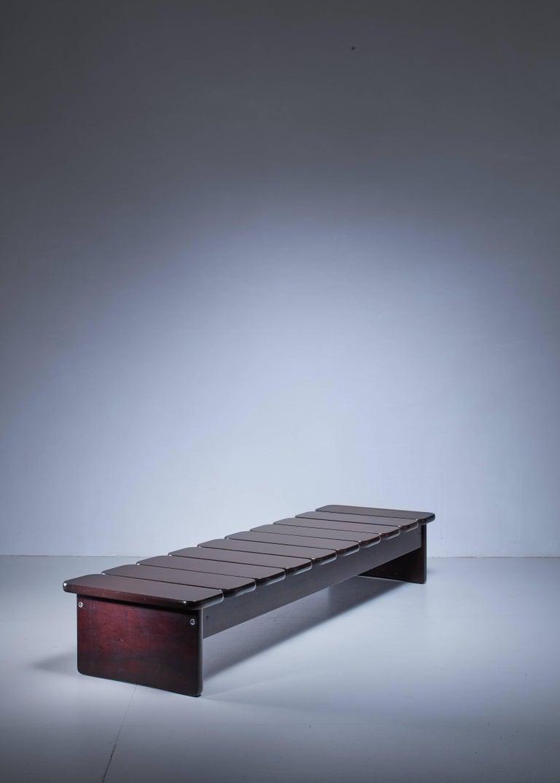 A wooden bench or daybed by Brazilian artist Geraldo de Barros for Hobjeto  Geraldo de Barros (1923-1998) was a Brazilian painter, photographer and designer. He was also active as a furniture designer, from 1954 at Unilabor, the company he
