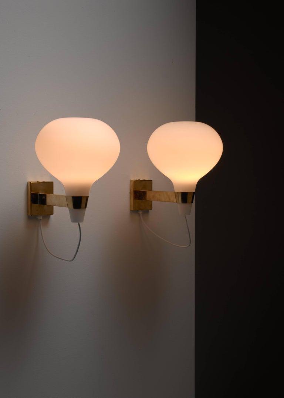 Scandinavian Modern Lisa-Johansson Pape Brass and Opaline Glass Wall Lamps, Finland, 1950s For Sale