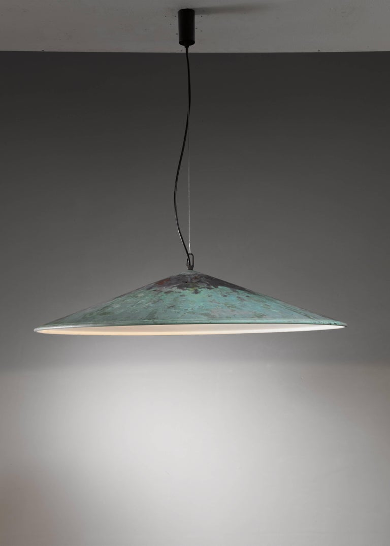 A very large (82 cm diameter) pendant lamp in verdigris copper, attributed to Danish designer Henning Larsen. We have a matching second lamp available to make a pair.