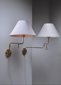 Pair of Swedish brass swiveling wall lamps, 1960s