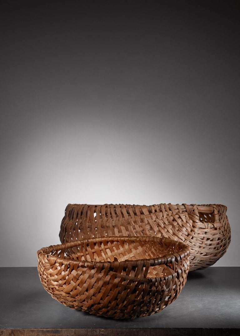 A pair of large Swedish Folk Art baskets, made of woven birch bark.