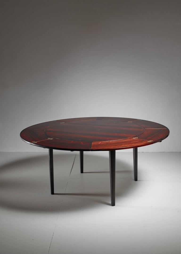 A 1960s Danish dining table by Dyrlund. The table has four extendable, fold-out parts to extend the table.